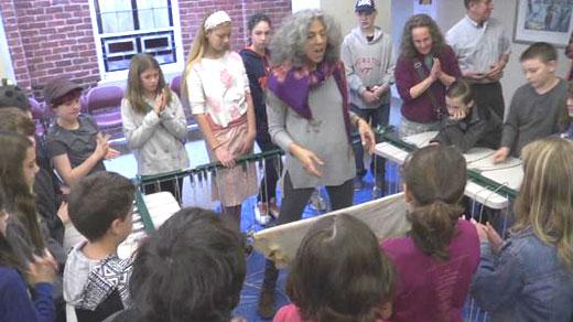 Rabbi Linda Motzkin instructing Congregation Beth Israel members on constructing a Torah scroll
