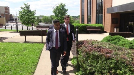 Martese Johnson and attornies leaving the federal courthouse in Charlottesville