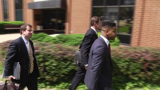 Martese Johnson and attornies leaving the federal courthouse in Charlottesville (FILE)