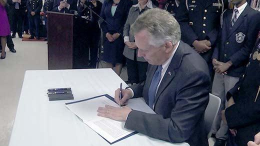 Governor McAuliffe signing bill