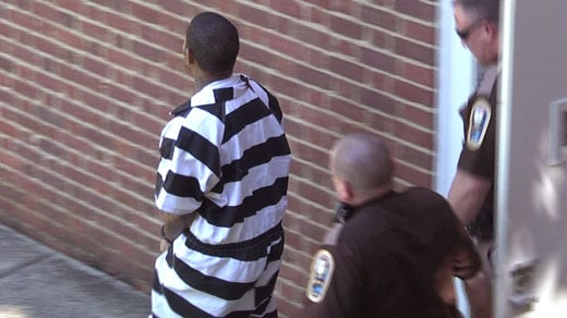 Gene Everett Washington being escorted from Charlottesville Circuit Court