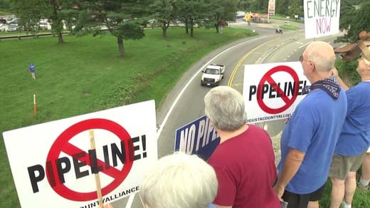 Demonstrators rallied in Afton as part of Hands Across Our Land