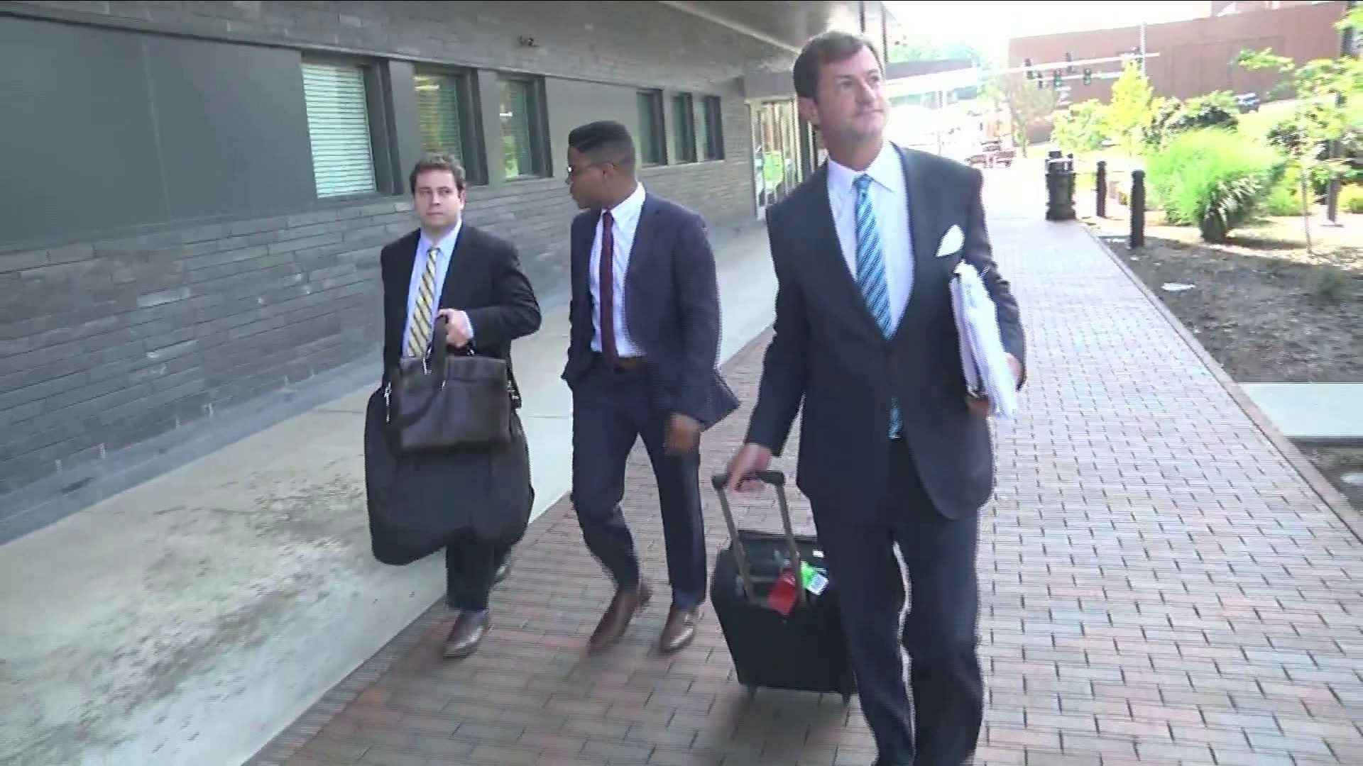 Martese Johnson (centered) with attorneys at a federal courthouse in Roanoke