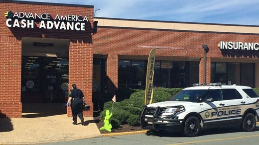Police on the scene of a reported robbery at Advance America