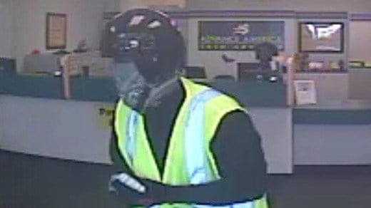 Surveillance image of suspect in robbery of Advance America
