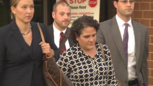 Nicole Eramo (center) leaving federal court with her legal team