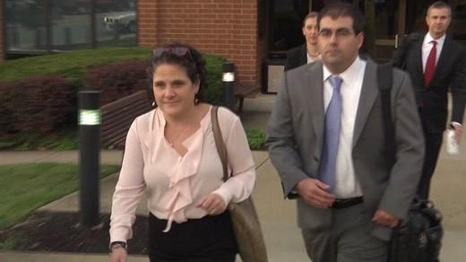 Former UVA Associate Dean Nicole Eramo and attorneis leaving federal court in Charlottesville (FILE)
