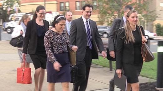 Nicole Eramo entering court with her legal team