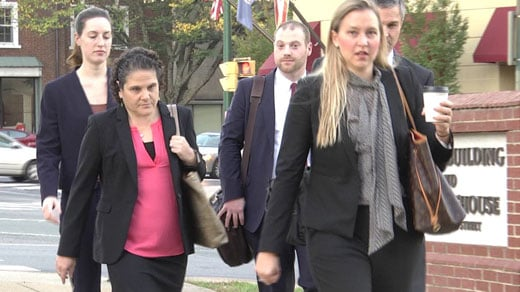 Nicole Eramo arriving to court with her legal team