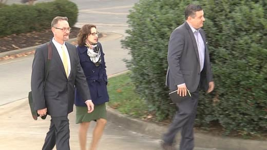An attorney, Sabrina Erdely and Sean Woods entering court in Charlottesville