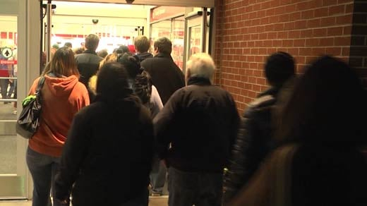 People filing into a retail store