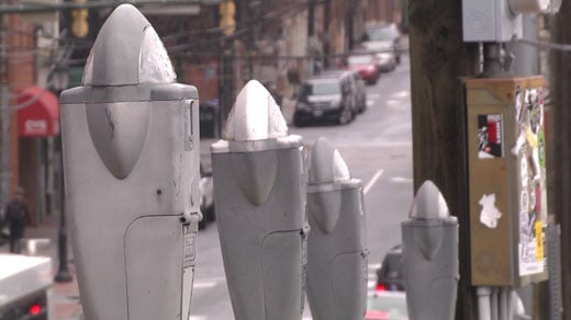 Parking meters in a lot by Water Street in Charlottesville
