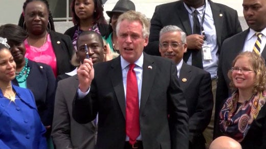 File Image: Governor Terry McAuliffe signing an order restoring civil rights to felons in Virginia