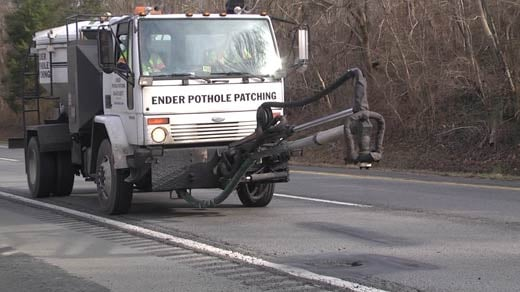 VDOT crew patching a pothole on Interstate 64