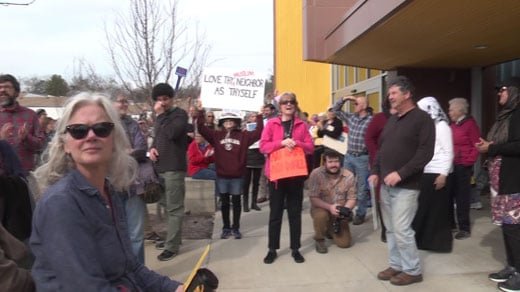 People gather in Albemarle County to protest Tom Garrett's support for President Trump