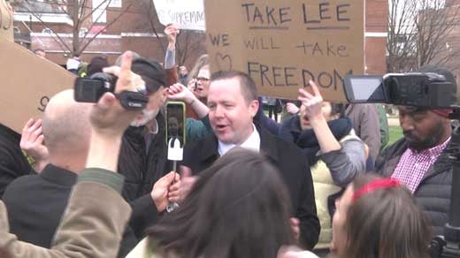 Corey Stewart at his rally in Lee Park surrounded by protesters