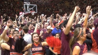 The Virginia Tech fans stormed the court following the victory