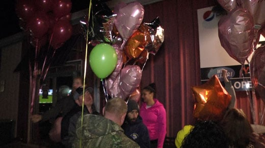"Friends and family of Robert ""Bobby"" ReauVeau gathered to release balloons in Belmont Thursday"