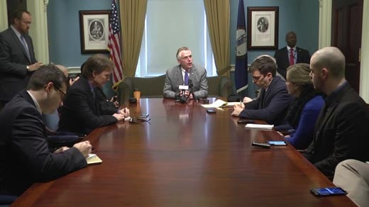 Governor Terry McAuliffe speaking with the press