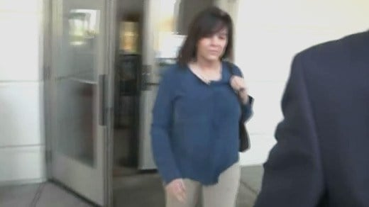 Anne Goland leaving a courthouse in Orange County