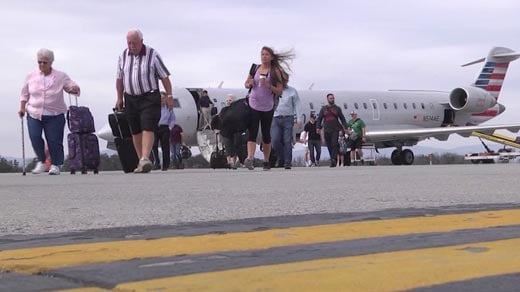 Passengers departing a plane at the Charlottesville-Albemarle Airport (FILE IMAGE)