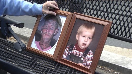 Robin Bryant places pictures on a bench of her son, Jason Lee Shifflett