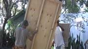 BGF members erect a piece of a ti kay they hope will provide some of the housing needed in Haiti.