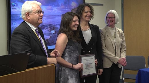 Clare Ruday receiving an award from the Virginia Department of Health