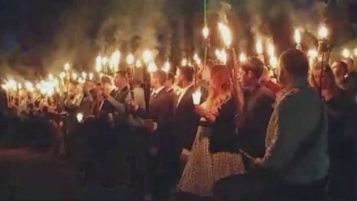 Supporters of the statue of General Robert E. Lee holding torches in Lee Park (Photo courtesy @realmemealert)