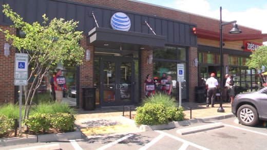 Barracks Road AT&T workers went on strike Friday afternoon
