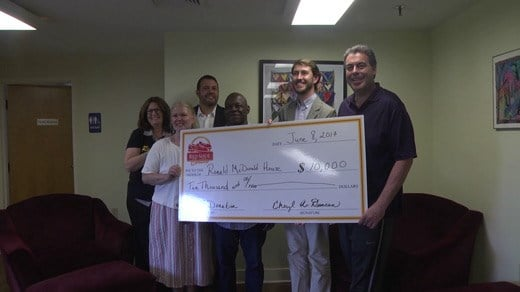 Red Shoe C-ville presents a check to the Ronald McDonald House