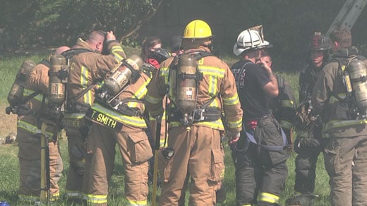 firefighters on scene at house fire on Spotswood Trail