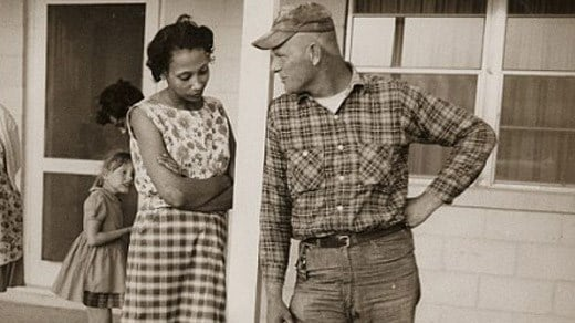 Mildred and Richard Loving, their daughter Peggy on the porch of Mildred's mother's house, Caroline County, Virginia in April 1965 (Courtesy Estate of Grey Villet)