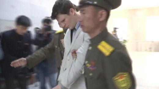 Otto Frederick Warmbier being escorted by North Korean officers (FILE IMAGE)