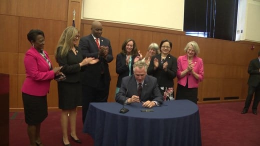Gov. Terry McAuliffe signing the bill in Richmond