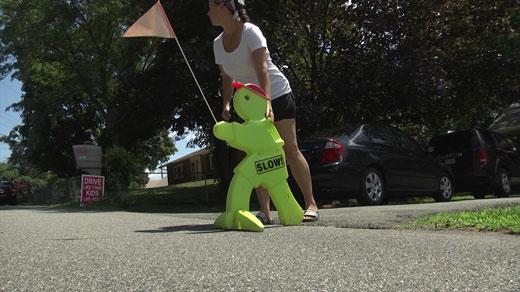 Michele Yeaton putting up sign in her neighborhood