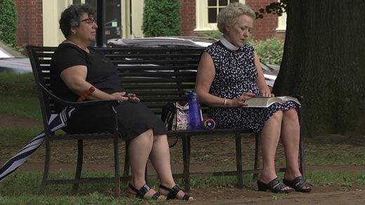 Rev. Susan Minasian and Rev. Elaine Ellis Thomas praying in Justice Park