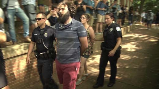 Charlottesville police arresting counter protesters at a KKK rally