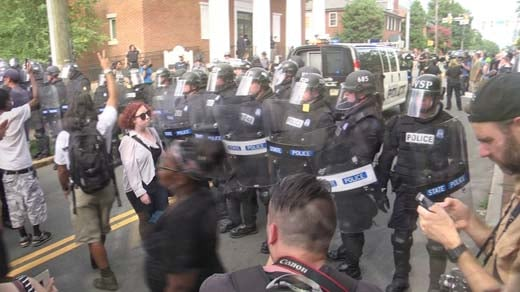 Police officers outfitted in riot gear on East Jefferson Street (FILE IMAGE)