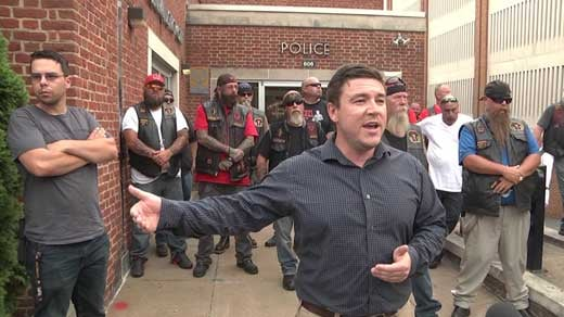 Jason Kessler with members of a motorcycle club in front of Charlottesville Police Department (FILE IMAGE)