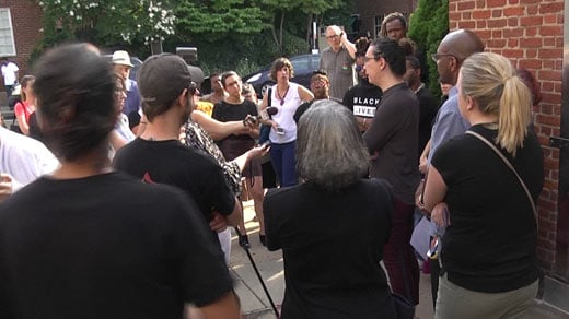 Members of Solidarity Cville holding a press conference in front of the Charlottesville Police Department