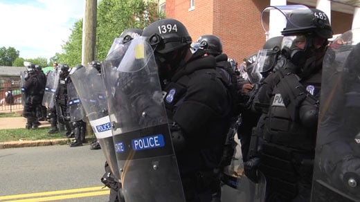Officers in riot gear facing off with protesters on East Jefferson Street after a rally by a KKK group in Charlottesville (FILE IMAGE)