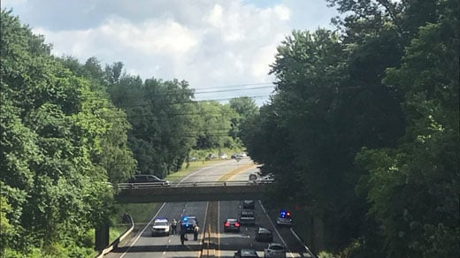 Scene of investigation of body found along Route 250 Bypass at Ivy Road