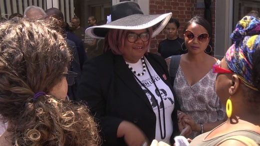 Supporters gather with Veronica Haunami Fitzhugh outside Charlottesville General District Court