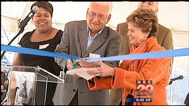 Paton Street neighbors and volunteers got together Sunday afternoon for a ribbon cutting and block party.