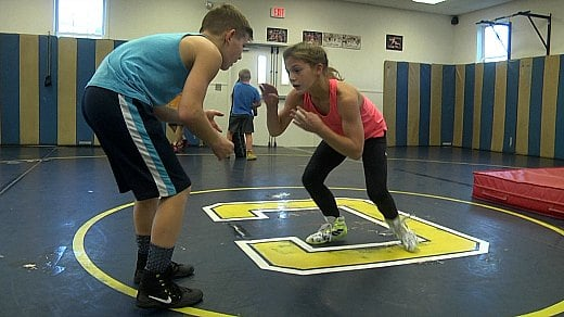 Virginia Foard first became interested in wrestling, while watching her brother's practices