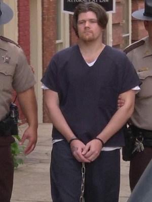 Steven Allen Lanier being escorted by authorities