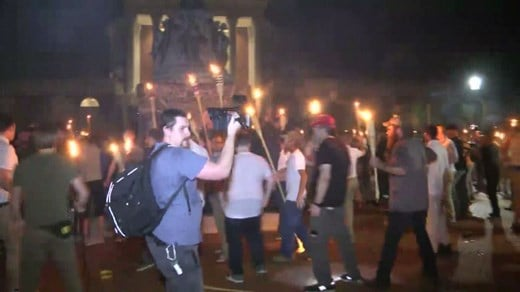 White supremacists hold torch-lit rally at UVA Jefferson statue before police break it up