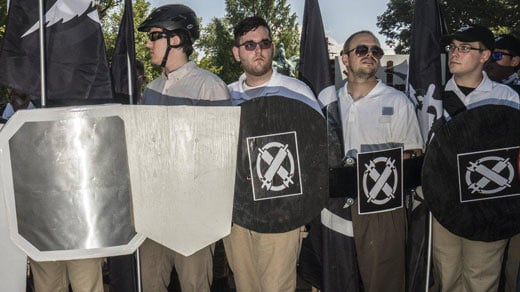 James Alex Fields Jr. (center) with a shield from the Vanguard America group  (Photo courtesy GO NAKAMURA/NEW YORK DAILY NEWS)