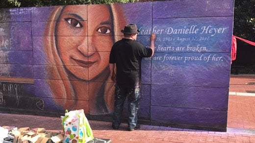An artist creates a tribute to Heather Heyer on Charlottesville's Freedom of Speech Wall